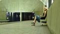 Woman waiting at Ballston-MU station (50088550338).png
