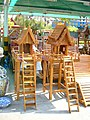 Wooden empty spirit houses.JPG