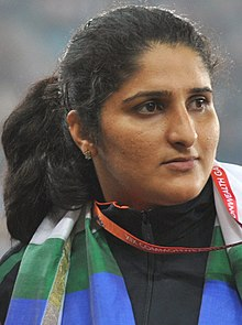 XIX Commonwealth Games-2010 Delhi Winners of Discus (Women's) Krishna Poonia of India (Gold), Harwant Kaur of India (Silver) and Seema Antil of India (Bronze) during the medal presentation ceremony of the event (cropped) - Seema Antil.jpg
