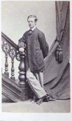 Young man leaning on banister by J W Black of Boston.png