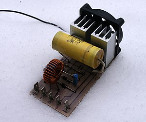 Switched-mode power supply - Zero voltage switched mode power supplies require only small heatsinks as little energy is lost as heat. This allows them to be small. This ZVS can deliver more than 1 kilowatt. Transformer is not shown.