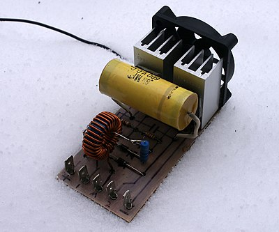 Zero voltage switched mode power supplies require only small heatsinks as little energy is lost as heat. This allows them to be small. This ZVS can deliver more than 1 kilowatt. Transformer is not shown. ZVS SMPS.JPG