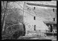 """Watermill grinding meal, run by H. L. Nicely, son of J. C. Nicely, at Goin, Tennessee. This old mill was built 100... - NARA - 532725.tif"
