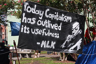 Banner at the 2012 Republican National Convention 'Today capitalism has outlived its usefulness' MLK.jpg