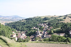 The church and surrounding buildings in Courzieu
