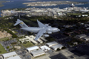 154th Wing C-17 Globemaster III flying over Hickam Air Force Base.jpg