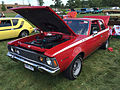 1971 AMC Hornet SC-360 compact muscle car in red at AMO 2015 meet 1of5.jpg