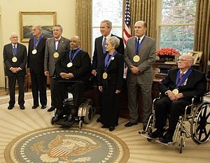 Paquito D'Rivera - U.S. President George W. Bush stands with recipients of the 2005 National Medal of Arts on 9 November 2005, in the Oval Office.