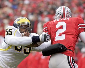 Michigan–Ohio State football rivalry - Terrelle Pryor (right) eludes Brandon Graham with a stiff arm.