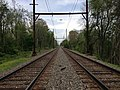 2014-05-12 13 09 23 View northeast along the Delaware and Bound Brook Railroad near River Road in Ewing Township, Mercer County, New Jersey.jpg