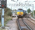 57 310 & 57 303 bring the Stowmarket-Clacton-Stowmarket RHTT working through Hythe station to a stop at Eastgates East Junction, before proceeding over the triangle towards Colchester North . Saturday 25th Oct 2014.jpg