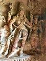 6th century Ardhanarishvara (left half Shiva, right half Parvati) with Nandi left, female attendant right (cave 1), Badami Hindu cave temple Karnataka 2.jpg