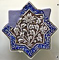8-pointed star tile, luster technique, glazed. Ilkhanate period, 2nd half of the 13th century CE. From Kashan, Iran. The Museum of Islamic Art (Tiled Kiosk), Istanbul, Turkey.jpg