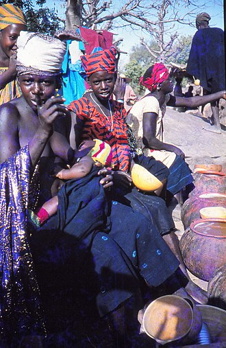 Marketing - Female beer sellers warn the photographer that he also has to buy some, Tireli market, Mali 1989