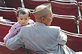 A Grandfather and a child in their spirits during the Beating the Retreat Ceremony in New Delhi on January 29,2006.jpg