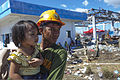 A Philippine Army rescue soldier holds a Filipino child while waiting to load on an aircraft for transport to Manila at the Tacloban Air Field, Philippines, Nov. 15, 2013 131115-M-UY543-072.jpg