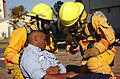 A member of Naval Air Facility Atsugi's Fire Department holds an injured man in his arms 021114-N-HX866-011.jpg