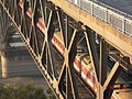 A passenger train crosses the Nanjing Yangtze River Bridge (flickr 8034632632).jpg