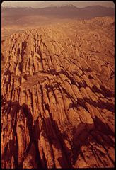 "Aerial View near Canyonlands National Park Showing ""The Fins,"" Just South of Moab. These Remarkable Formations Lie Beyond the Boundaries of the Park Itself, 05-1972 (3814169171).jpg"