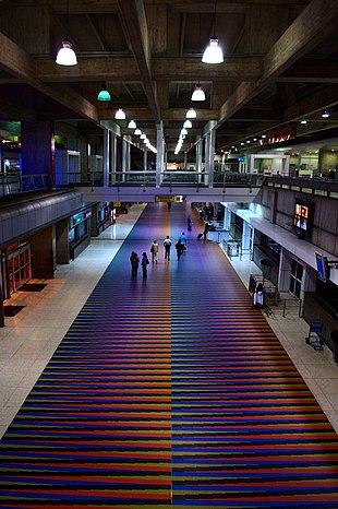 Airport terminal, with colorful floor tiles