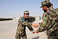 Afghan officer congratulates a basic trainee after graduation at Camp Shorabak.jpg