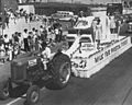 Alberta Dairy Princess Denise Aumuller sitting on a float in a parade (27655705511).jpg