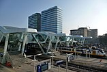 Almost completed new traverses at Arnhem Central station with essent and Arcadis towers as background - panoramio.jpg