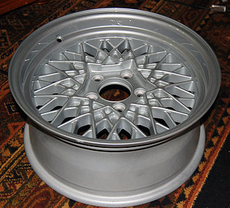 Alloy wheel - An aluminum alloy wheel designed to recall the crossed spokes of a wire wheel