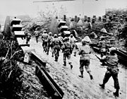 US soldiers crossing the Siegfried Line.