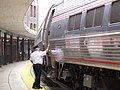 Amtrak conductor finishing up station stop in Staunton.jpg
