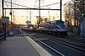 Amtrak passing MARC train Odenton.jpg