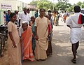 An old lady being assisted to come at a polling booth of Viruthunagar Parliamentary Constituency to cast her vote during the 5th and final phase of General Election-2009, in Tamil Nadu on May 13, 2009.jpg
