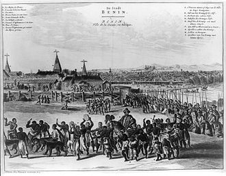 Nigeria - Benin City in the 17th century with the Oba of Benin in procession. This image appeared in a European book, Description of Africa, published in Amsterdam in 1668.