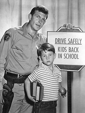 Opie Taylor - A publicity photo from The Andy Griffith Show showing Griffith and Howard in character as Andy and Opie Taylor (1961)