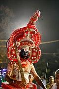 Angakkaaran Theyyam.jpg