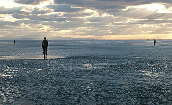 "Sculpture ""Another Place"" by Antony Gormley."