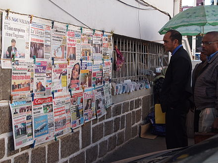 A news stand in Antananarivo Antananarivo Madagascar people reading news.JPG