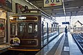Arashiyama line train at Shijo Omiya Station, May 2017.jpg