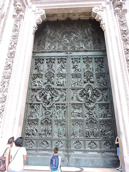Artwork on the door of the Cathedral. Art work on door Milan Cathedral ,Italy.jpg