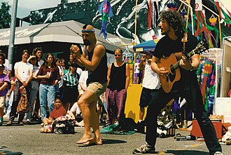 Artis the Spoonman - Artis (left) performing with Jim Page at Seattle's University District Street Fair (1993)