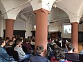 Arwen Elys Dayton giving a presentation on her Seeker Series at a high school in Germany.jpg