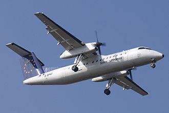 Augsburg Airways - A Dash 8-300 of Augsburg Airways approaches Stuttgart Airport in 2005, still in Team Lufthansa colors.