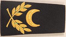 https://upload.wikimedia.org/wikipedia/commons/thumb/5/53/Aumonier_musulman.jpg/220px-Aumonier_musulman.jpg