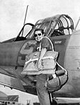 Avenger Field - WASP Trainee poses with a Vultee BT-13 Valiant.jpg