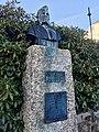 Baard Haugland memorial from 1919 in Leirvik, Stord, Norway. Portrait bust by Torleiv Agdestein. Rhododendron. Photo 2018-03-10 a.jpg