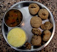 Baati with dal and shrikhand.