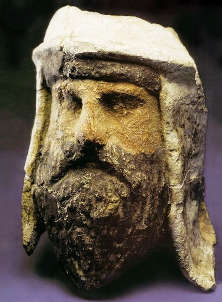 Painted clay and alabaster head of a mobad wearing a distinctive Bactrian-style headdress, Takhti-Sangin, Tajikistan, Greco-Bactrian Kingdom, third–second century BC