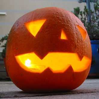 Jack-o'-lantern - A traditional jack-o'-lantern, made from a pumpkin, lit from within by a candle.