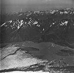 Bear Glacier, terminus of valley glacier, icebergs in the lake, and medial moraines, September 4, 1977 (GLACIERS 6847).jpg