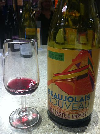 Beaujolais - A glass and bottle of Beaujolais Nouveau from the 2013 vintage.
